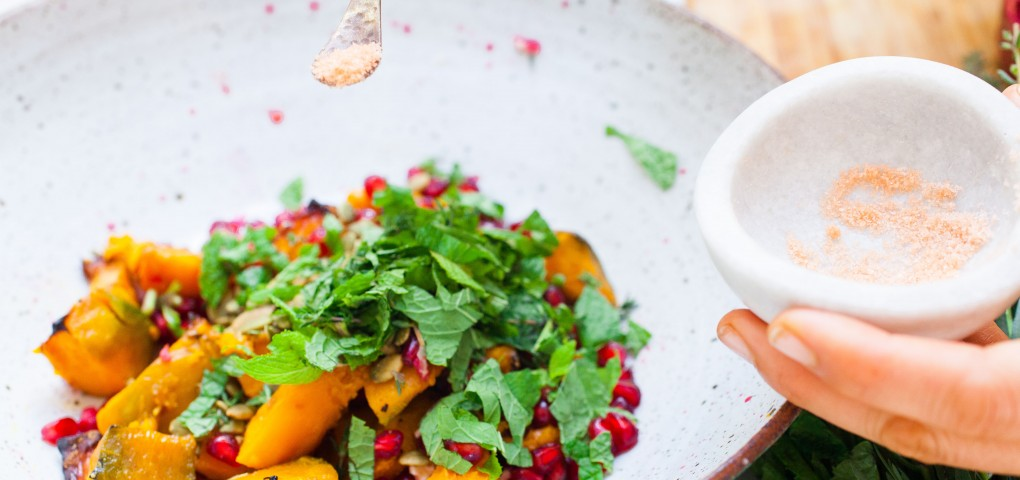 The Local Rose shares an all-natural recipe for Kabocha squash with pomegranates and pumpkin seeds, topped with tarragon, oregano, mint and parsley.
